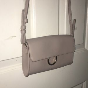 Beige neutral purse with gold hoop accent